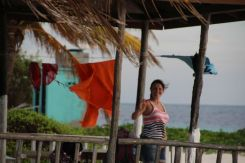 Marty getting on with the household chores of hanging out the washing on Goffs Caye