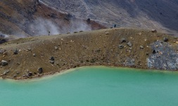 Thermal Steam rising behind hikers at Emerald Lakes
